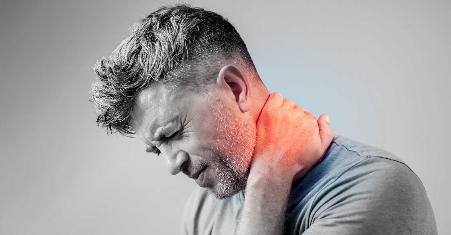 Man holding neck after a car accident due to whiplash pain